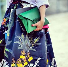 a floral skirt with a pop of emerald