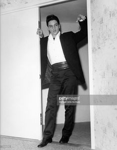 News Photo : Rock and roll musician Elvis Presley poses for a...