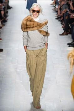 michael kors... the fur is atrocious. How about a traditional plaid scarf instead keep the fur where it belongs, on the one born with it!
