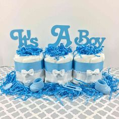 It's A Boy Mini Diaper Cake Centerpiece It's A Boy diaper cake centerpiece for your boy baby shower. It includes 3 mini diaper cakes side by side and can be customized at no additional charge. Idee Baby Shower, Shower Bebe, Baby Shower Diapers, Baby Shower Cakes, Baby Shower Themes, Baby Boy Shower, Baby Shower Gifts, Baby Showers, Diy Diaper Cake