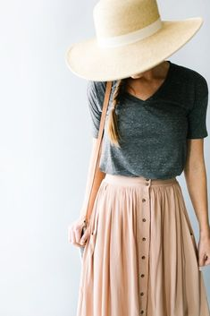 T-shirt tucked in, long skirt that sits at the waist, big hat