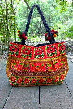 Check out this item in my Etsy shop https://www.etsy.com/listing/209792176/hmong-embroidery-gypsy-floral-tote