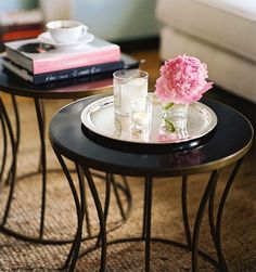 pretty flowers and candles... coffee and books. Two tables instead of one coffee table. loving it all.
