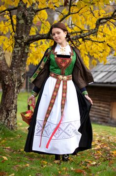 The bunad from Hardanger is a living tradition and has evolved from a folk costume. The different regions are indicated in the detailing on the costumes. This bunad has a green silk bodies and a black woolen skirt. The white apron has inlaid embroidery, which is known as Hardanger embroidery.  - Hardanger Folkemuseum, (from 1911-) in Norway