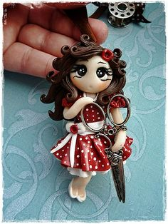 Polymer clay girl with scissors