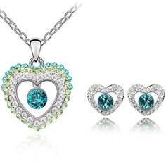 This gorgeous set is 18k white gold plated and features sparkling Swarovski Austrian Crystal elements. The lovely sparkle and elegance of this charming piece is perfect for everyday wear or special occasions. You are sure to be delighted by the beauty of these high quality crystal stones. Your lovely new jewelry set will come to you tucked inside a beautiful velvet pouch complete with gift box. Perfect as a gift or treat for yourself. For your convenience, we have provided measurements under…