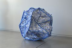 sculpture made out of sticks and tin-foil representing depletion of resources