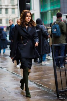 Christine Centenera in a black blazer + black pencil skirt + army green over-the-knee boots