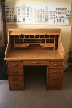 A Pine Roll Top Desk. Original handles.  www.thedeskcentre.co.uk