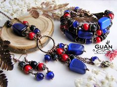 """#Beautiful combination of red #coral and blue cat's eye . #Bracelet , #necklace and #earrings created by Russian designer Anna #Gulevich within the #collection """" #Arabian #Night """" __________________________  #jewellery #blue #red #lampwork #lampworking #murano #muranoglass #inspiration #love #fashion #fashionista #fashionblogger #jewelryblogger #lady #arabianNight #night #egypt #east #fairytale #Morocco #Moroccan"""