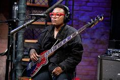 Meshell Ndegeocello sits in