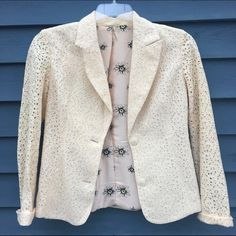 Cream Lace Blazer Cream colored lace blazer with flower lining. Collared with 2 buttons, sleeves meant to be rolled. Fits sizes 4-6.  Sleeves do not have lining.  Excellent condition. Worn less than 5 times. Lining is polyester. Outer is 100% cotton Awake Couture Jackets & Coats Blazers