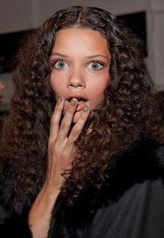 Marina Nery.   *This curly hair style is great for Oval, Oblong, Square, and Diamond face shapes