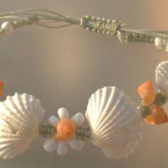 Shell macrame bracelet with cockle shells and mongo shells on pale sea green nylon cord.