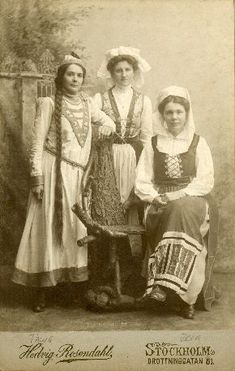 Early 1900's photograph of women in folk dress, all from different regions in Sweden.