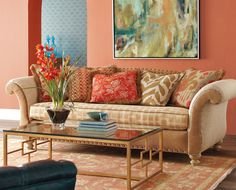 accents of persimmon and turquoise with a neutral sofa