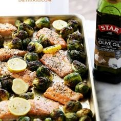One Sheet Pan Garlic Roasted Salmon with Brussels Sprouts - Incredibly delicious, garlicky, super flavorful one-pan dinner with oven-roasted salmon and brussels sprouts. Whole30 Salmon Recipes, Fish Recipes, Seafood Recipes, Healthy Dinner Recipes, Cooking Recipes, Delicious Meals, Meal Recipes, Seafood Dishes, Healthy Meals