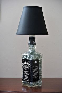 Jack Daniels glass bottle lamp for his man cave! Get yours by clicking on the pi… Jack Daniels glass bottle lamp for his man cave! Get yours by clicking on the picture. Lampe Jack Daniels, Jack Daniels Decor, Jack Daniels Bottle, Glass Liquor Bottles, Liquor Bottle Crafts, Alcohol Bottles, Alcohol Bottle Decorations, Liquor Bottle Lights, Diy With Glass Bottles