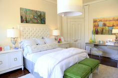 Keeping most of the room white and neutral allows the few things that are colorful to really pop.  Plus, it gives you the option to change them out easily and affordably.