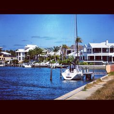 Mandurah, Australia.  Sailboat on the water in front of nice homes by wHeregroup, via Flickr