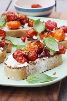 Slow-roasted Tomato Ricotta (or goats cheese) Bruschetta. Tomatoes that have roasted in the oven for an hour, Crusty French bread grilled to perfection. Bruchetta, I Love Food, Good Food, Yummy Food, Slow Roasted Tomatoes, Vegetarian Recipes, Cooking Recipes, Appetisers, Italian Recipes
