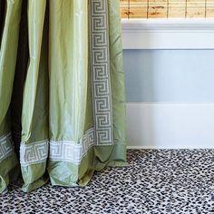 Apple green silk taffeta drapes with light blue greek key tape trim AND a leopard carpet
