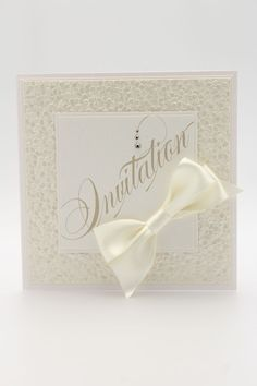 Pebble Frame Wedding Invitation is a elegant embossed design available from The Wedding and Flower Boutique.