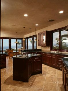Love the wall color's and cabinets and marble and brown molding