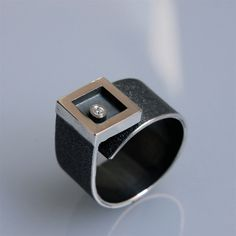 "Contemporary ring ""morningstar"" in oxidated silver with diamond by andreasschiffler on Etsy https://www.etsy.com/listing/72907200/contemporary-ring-morningstar-in"