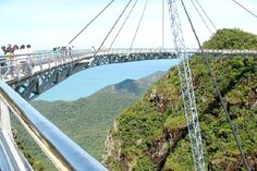 The LANGKAWI SKY BRIDGE is located in Malaysia and is suspended 700 metres above sea level and spans 125 across the mountains, offering wonderful views of the Andaman Sea and Thailand's Tarutao Island. Scary Bridges, Rickety Bridge, Cable Stayed Bridge, Sky Bridge, Bridge Design, Sea Level, Civil Engineering, Pedestrian, Countries Of The World