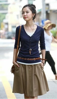 Layered top, knee-length skirt.