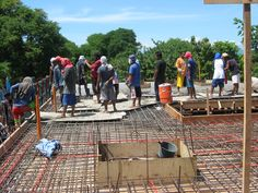 35. pouring cement on the roof. about 40 cubic. team worked 18 hours. 3 team. over 50 people