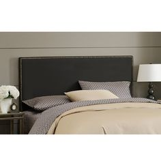 Give your bed a modern look with this king-size nail button headboard from Wrightwood. Upholstered in classic black micro-suede, this headboard is soft, looks great, and is ready to be easily attached to most standard metal bed frames.