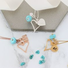 A personalised sterling silver, rose gold or gold turquoise birthstone heart necklace with initial charms and birthstone gemstones to create a uniquekeepsake gift for her to treasure. Birthstone Charms, Birthstone Necklace, Turquoise Birthstone, Turquoise Jewellery, December Birthday, Letter Charms, Christening Gifts, Initial Charm, Birthstones