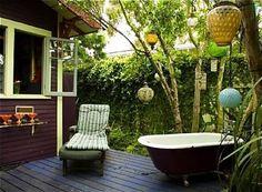 Outdoor Bathtub Ideas black bathtub outside by a tree