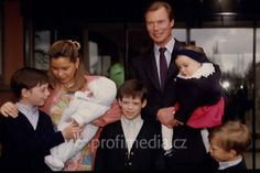 And then there were five.  Grand Duke Henri and Grand Duchess Maria Teresa of Luxembourg with all their children.  Front:  Princes Guillaume, Felix, and Louis.  Back, right:  Grand Duke Henri holding Princess Alexandra.  Back, left:  Grand Duchess Maria Teresa holding baby Prince Sebastien.