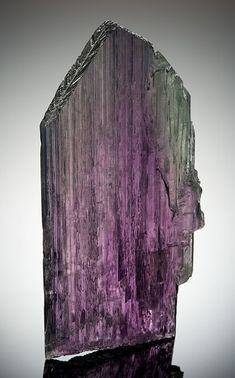 The Big Kahuna --   The Big Kahuna is one of the top two, perhaps three, American kunzite specimens known. It was the discovery of large gemmy crystals of this pink to lilac to violet spodumene (the mineral species name) in San Diego County's Pala district that led to its naming as a new gem variety, kunzite. It is named after George F. Kunz, who was Tiffany's chief gemologist and vice-president a century ago, at the time of the discovery.  . . . Spodumene (kunzite); 28 cm tall (15.6 cm wide; 2 cm thick).