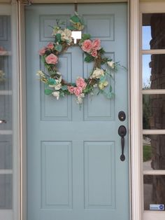 My newly painted front door. Benjamin Moore Stratford Blue.