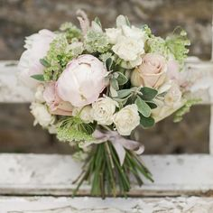 We love this stunning bouquet with peonies and roses... What flowers will you have in your bouquet? www.wed2b.com