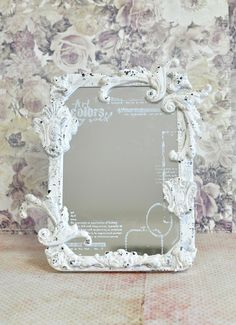 Frame an inexpensive mirror for a one-of-a-kind wonder! Maiko Miwa added paperclay pieces to frame her mirror creating a very unique, very beautiful accent piece for her home