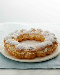 Paris Brest, pate choux cake filled with pastry cream and whipped cream. Recipe via Martha Stewart Paris Brest, French Desserts, Classic Desserts, Just Desserts, Dessert Recipes, Profiteroles, Cake Pops, Recipes With Whipping Cream, Martha Stewart Recipes