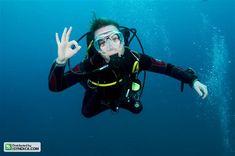 woman scuba diver | woman scuba diver swimming in clear blue… | By ...