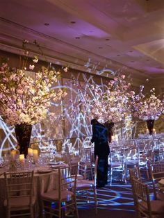 A gorgeous wedding at the Four Seasons Hotel - Boston. All of the gorgeous photos were captured by the talented Sarah Lawrence undergrad, Emma Wheeler. Call us today for a consultation at 617-482-6272. #luxurywedding #theworldofmarchall @fsboston @sarahlawerence @emmawheeler #weddingreception #centerpiece #dogwoodbranch #white #pink #green