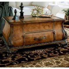 Butler Specialty Company Bombe Trunk Table - Heritage - 0553070. Butler Specialty Company Bombe Trunk Table - Heritage - 0553070 Old world map glazed and laquered surface. Geunine leather appointments. Working drawer. Product Specifications Dimensions 25.5 D x 38 W x 19 H (inches) Finish.. . See More Cocktail Tables at http://www.ourgreatshop.com/Cocktail-Tables-C695.aspx