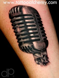 Black and gray vintage microphone tattoo done by David Palacios