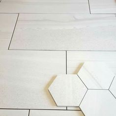 "Legend Blanco 12 x 24"" with matching hexagon mosaic"