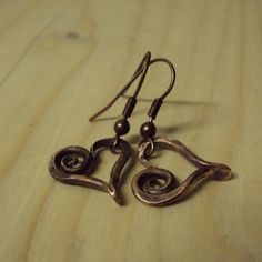 Forged from copper and then polished. Size of hearts is about 1.5 cm without hooks.  Earrings can be worn alone or as a supplement with pendant which