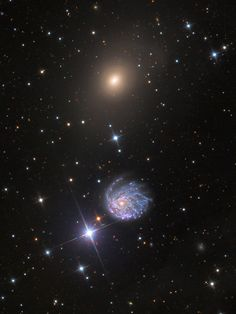 "NGC 2276 and NGC 2300 are ""boundary"" targets in that they are the northernmost objects in the New General Catalog of space stuff. NGC 2276 is a beautiful spiral galaxy that is punctuated by pink star forming regions. In fact it has one of the highest rates of star formation that has been measured. Its neighbor, NGC 2300, appears as a regular elliptical galaxy that shows some evidence of shells (and perhaps former structure)."