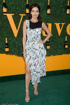 Flawless: Camilla Belle showed off her winning looks in a smart dress with a slit up the f...