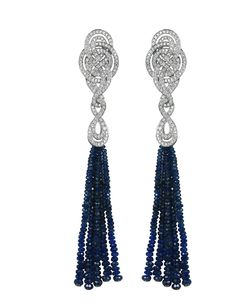 Garrard earrings from the Entanglement collection with diamonds and sapphire tassels, set in gold.